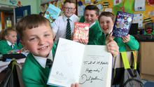 (L-R) Bobby (8), Oran (10), John-Paul (11) and Sean (8) show off the new special additions to the school library. (Darren Kidd / Press Eye.)