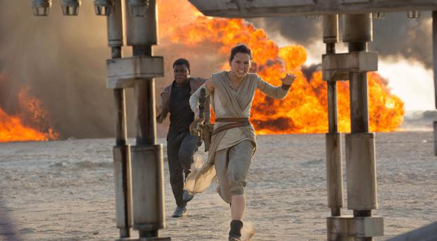 Daisy Ridley as Rey and John Boyega as Finn in a scene from Star Wars: The Force Awakens