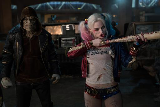 Pretty crazy: Margot Robbie as Harley Quinn and Adewale Akinnuoye-Agbaje as Killer Croc in Suicide Squad