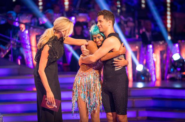 Tess Daly consoles Naga Munchetty and Pasha Kovalev after the couple were voted out of Strictly Come Dancing