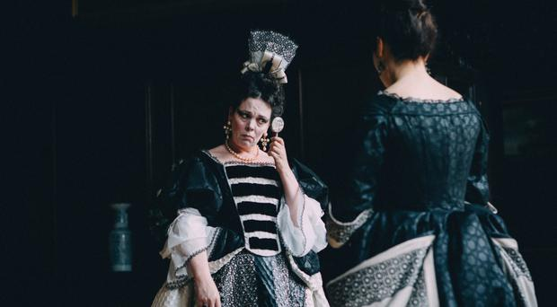 Majestic roles: Olivia Colman as Queen Anne in The Favourite. She will also soon play Queen Elizabeth II in The Crown