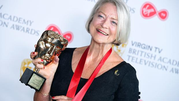 Kate Adie with her fellowship award (Ian West/PA)