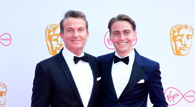 Bradley Walsh suffered a spinal injury while filming in the US with his son Barney (Ian West/PA)