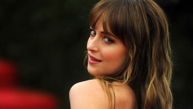 Dakota Johnson stars in Fifty Shades Of Grey