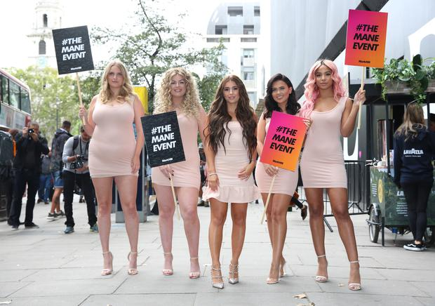Dani Dyer (centre) helps to kick start Mark Hill's #TheManeEvent campaign outside the LFW show space (Isabel Infantes/PA)
