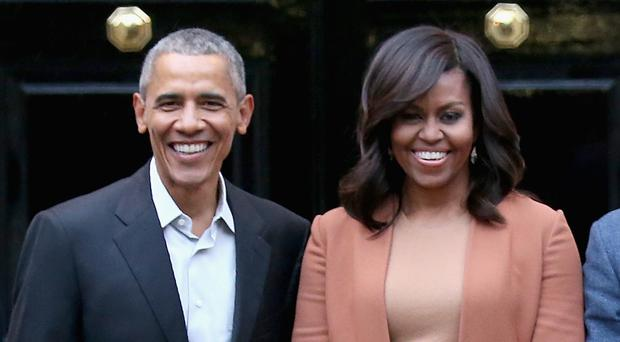 Barack Obama and his wife Michelle operate Higher Ground Productions (Chris Jackson/PA)