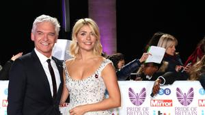 Phillip Schofield and Holly Willoughby will return as presenters of Dancing On Ice (PA)