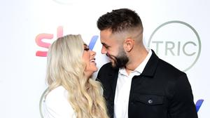 Love Island winners Paige Turley and Finley Tap share kiss at the Tric Awards (Ian West/PA)
