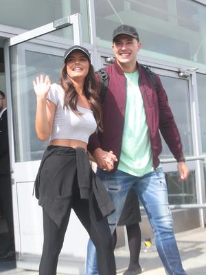Maura and Curtis held hands as they left the airport (PA)