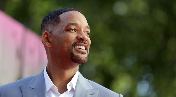 Will Smith faces off against a younger version of himself in his new film (Daniel Leal-Olivas/PA)
