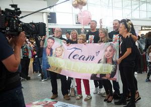 Family and friends of Love Island runner up Molly Mae Hague pose for a picture as they wait for her arrival at Stansted (Yui Mok/PA)