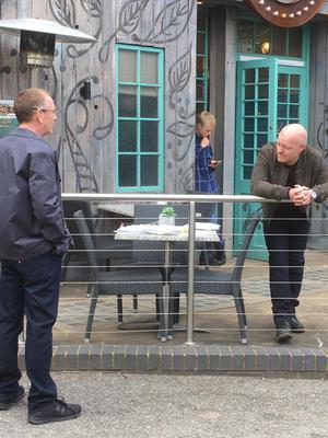 Adam Woodyatt (Ian Beale), Clay Milner Russell (Bobby Beale) and Jake Wood (Max Branning) practise social distancing as the cast and crew of EastEnders return to work (BBC/PA)