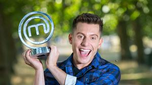 Riyadh Khalaf, the winner of Celebrity MasterChef, with his trophy (Dominic Lipinski/PA)