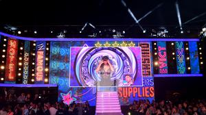 Winner Ryan Thomas is interviewed as Roxanne Pallett is shown on the big screen during the live final of Celebrity Big Brother at Elstree Studios, Hertfordshire (Ian West/PA)