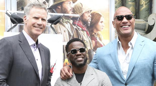 Dwayne 'The Rock' Johnson and Will Ferrell supported Kevin Hart as he received one of Hollywood's oldest honours (Willy Sanjuan/Invision/AP)