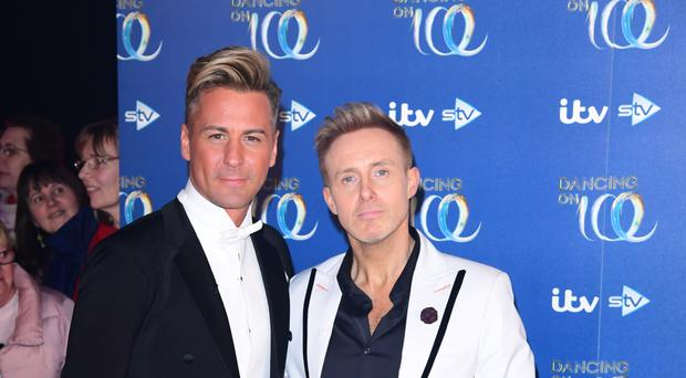 Matt Evers and Ian 'H' Watkins at the launch of Dancing On Ice 2020 (Ian West/PA)