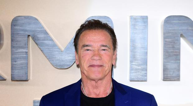 Arnold Schwarzenegger shared a picture of him skiing with fellow actor and friend Clint Eastwood (Ian West/PA)