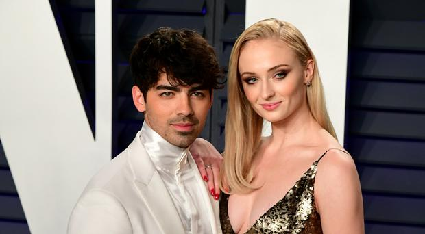 Joe Jonas and Sophie Turner have got matching tattoos in memory of their dog (Ian West/PA)