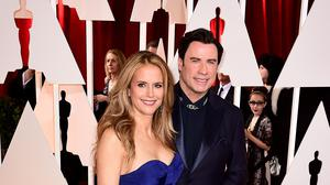 John Travolta and wife Kelly Preston arriving at the 87th Academy Awards in 2015 (PA)