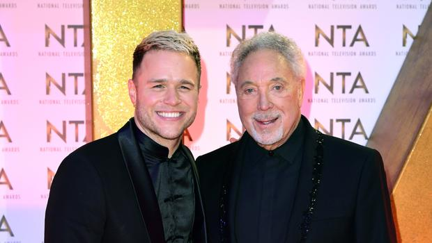Olly Murs and Tom Jones during the National Television Awards (Ian West/PA)