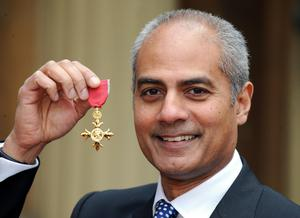 George Alagiah after collecting his OBE (Fiona Hanson/PA)