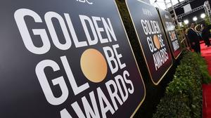 The 78th Golden Globes will be broadcast from separate coasts of the US, with Tina Fey and Amy Poehler hosting from New York and Los Angeles (Jordan Strauss/Invision/AP, File)