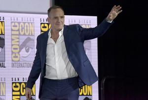 Clark Gregg waves to the audience as he walks on stage at the Agents of S.H.I.E.L.D. panel on day one of Comic-Con International (Richard Shotwell/Invision/AP)