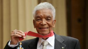 Actor Earl Cameron outside Buckingham Palace with his CBE (Anthon Devlin/PA)