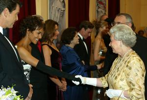The Queen meets actress Halle Berry at the premiere (PA)