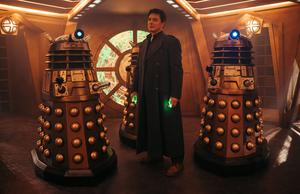 Captain Jack Harkness (John Barrowman) and the Daleks (James Pardon/BBC Studios)