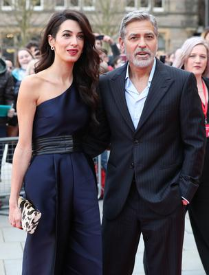 George and Amal Clooney have donated more than one million dollars to the coronavirus relief effort (Andrew Milligan/PA)