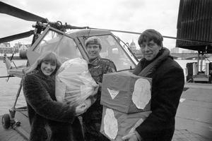 Blue Peter presenters Lesley Judd and John Noakes receive a special delivery from Captain Mike Bell of the Third Regiment, Army Air Corps, Wiltshire, containing 30,000 stamps for Blue Peter's Lifeline Lebanon Appeal (PA)
