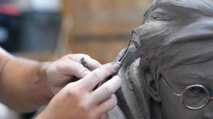 Sculptor Andrzej Szymczyk crafts a life-size statue of Harry Potter (Heart of London Business Alliance/PA)