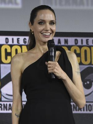 Angelina Jolie made a surprise appearance at the Marvel Studios panel at Comic-Con (Chris Pizzello/Invision/AP)