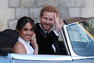 The newly married Duke and Duchess of Sussex, Meghan Markle and Prince Harry, leaving Windsor Castle after their wedding to attend an evening reception at Frogmore House, hosted by the Prince of Wales (Steve Parsons/PA)