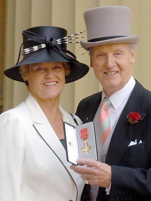 Nicholas Parsons with his wife Annie after receiving a OBE (Michael Stephens/PA)