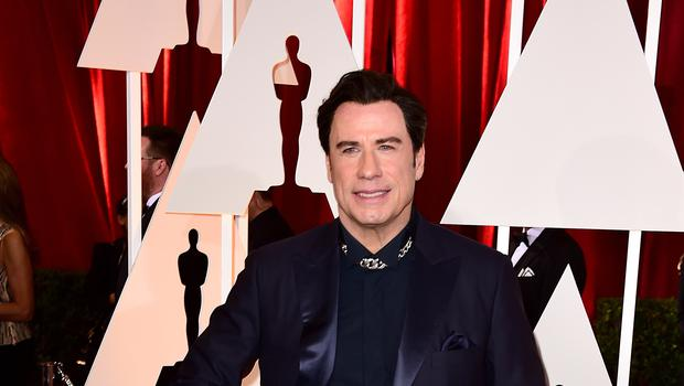 John Travolta swivelled his hips and bopped around the dancefloor (Ian West/PA)