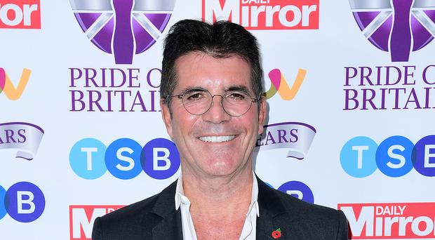 Simon Cowell has signed a new deal with ITV (Ian West/PA)