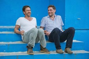 Butler with , Magnus MacFarlane-Barrow (Chris Watt)Gerard Butler in Liberia as part of a visit to Mary's Meals projects.