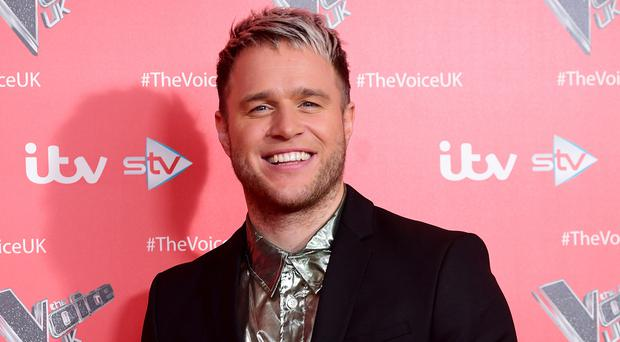 Olly Murs talks about the impact of his new romance after years of being single (Ian West/PA)