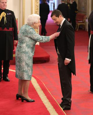 Bear Grylls is made an OBE by the Queen (Yui Mok/PA)