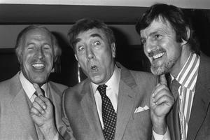 Frankie Howard puts his fingers on two of the most famous chins on television, Bruce Forsyth and Jimmy Hill (PA)
