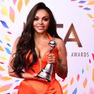 Jesy Nelson with the factual award in the NTAs press room (Ian West/PA)
