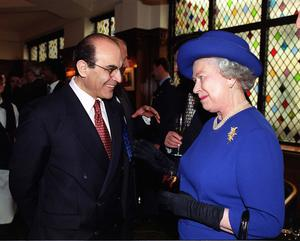 David Suchet with the Queen in 1999 (John Stillwell/PA)