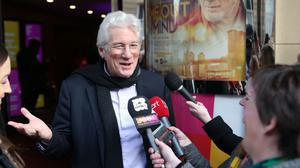 Richard Gere talks to waiting media as he attends the UK premiere of his movie, Time Out of Mind