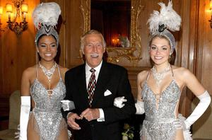 On his 80th birthday he was joined by Miss Puerto Rico (left) and Miss England dressed as showgirls (PA)