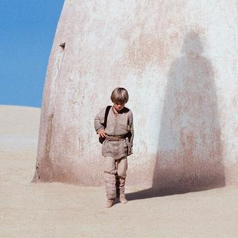 FILE - In this publicity photo released by Lucasfilm Ltd., actor Jake Lloyd portrays Anakin Skywalker, a young Darth Vader, in