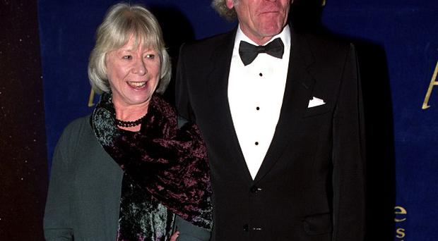 Peter Gilmore, pictured with Anne Stallybrass, has died at the age of 81.