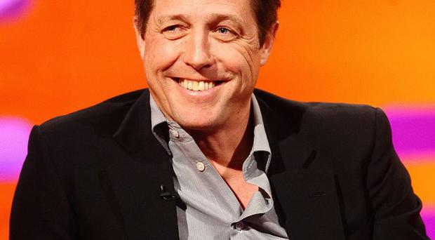 Hugh Grant's film Love Actually has topped a romance poll