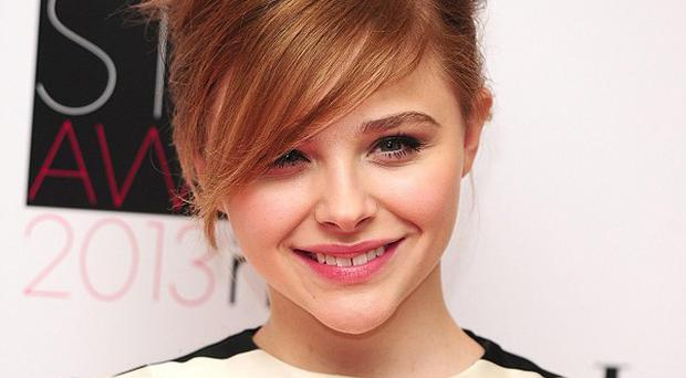 Chloe Moretz says Hit-Girl will be more grown up in Kick-Ass 2